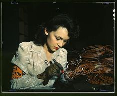 Woman aircraft worker, Vega Aircraft Corporation, Burbank, Calif. Shown checking electrical assemblies (LOC)    Bransby, David, photographer.    1942 June    Farm Security Administration - Office of War Information Collection