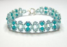 An elegant aqua and teal swarovski bracelet made using blue zircon swarovski bicones, light teal AB czech firepolish and light aqua AB seed beads