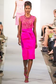 Neons are a Spring 2012 trend.  I love the lace top with neon skirt and strappies.   Oscar de la Renta