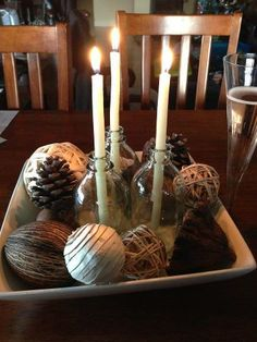 I found these cute little bottles for $2.80, 3 long organic beeswax candles (which you can purchase through Eco Family Store on face book for $3 each)  and a bunch of pine cones scattered in one of my salad bowls makes for a very affordable and ambient Christmas Table Decoration :)