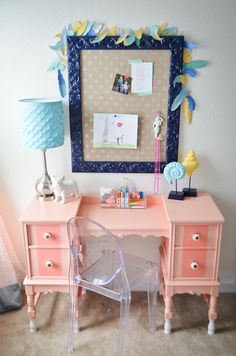 Girl's Pink Antique Desk with DIY Corkboard - the scalloped lampshade and feather garlnd (both DIYs) add a touch of eclecticism to this big girl room!