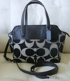 The Coach Taylor Signature Bette Mini Tote Crossbody is a Very Sophisticated Handbag. In Classic Sateen Black and Trimmed in Smooth Leather it Drips with Luxury. Although it is One of the Finest Handbags you Can Purchase this Tote is very Functional and Matches with Everything in Your Wardrobe. T...