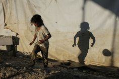 https://flic.kr/p/oSjDZ1 | 2014 LEBANON JUNE - SYRIAN REFUGEES403 | A girl plays with a ball at a Syrian refugees camp in a camp on June 18, 2014 in the Lebanese village of Zahle in the Bekaa valley. Matthieu ALEXANDRE for CARITAS INTERNATIONALIS