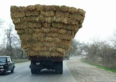 lots of bales of hay and a small hay truck - my dad could stack a truck like this.  Just hoped it won't fall apart all over the road!