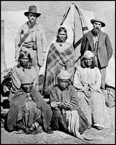 Modoc women prisoners and non-native men, Captain Applegate & Frank Riddle. Kaitchkona Winema or Toby Riddle (standing), Laceles, Mehunolush, Saukaadush, and Lauwlauwwaush. Photographed: 1873. - National Anthropological Archives, Smithsonian Institution.