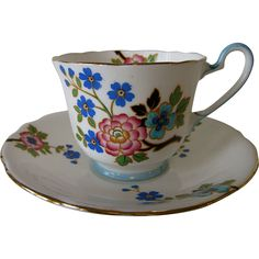 Delightful Aynsley collector's cup with hand-finished, raised enamel flowers on a snow-white background. Green backstamp dates this set to 1934-39, the same era as the famous butterfly and flower handle cups. 50% discount Nov. 25-29 #MusesAntiques #RubyLane