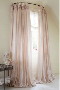 use a curved shower rod for window treatment/So pretty! Could use spray paint change out the silver. Asw