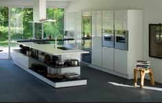 Risultati immagini per open space cucina con isola e parquet