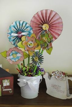 Paper flower decorations  These would be so cute for decorating a party or shower.