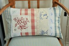 striped cushion with ribbons and buttons by mybearpaw, via Flickr