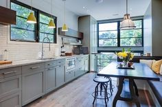 Beautiful painted kitchen cabs with natural wood accents