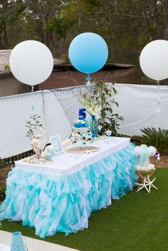 Gorgeous decorated table at a sea princess birthday party! See more party planning ideas at CatchMyParty.com!