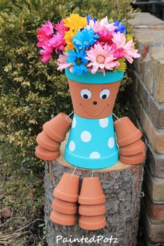 Blue painted flower pot person
