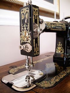 White Family Rotary Treadle Sewing Machine and Cabinet