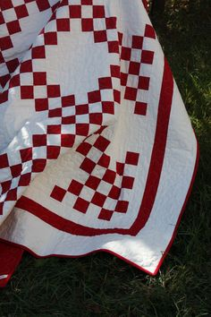 love a red and white quilt. double irish chain quilt