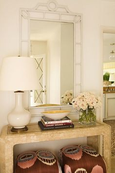 Crushing hard on faux bamboo-- and if that is wrong I don't wanna be right. Working on finding the perfect bamboo mirror for my entry way.  If I stumble on an amazing horn (pearl?) console like this one, I'll be scooping that up, too!  So much texture for a light, monochromatic scene.  I like the pop of color with the ikat stools, but it makes me wonder--  where do these people dump their keys/junk mail/etc.? I'd swap out the stools for some pretty baskets.