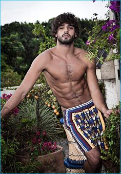 Going shirtless, Marlon Teixeira models graphic swim shorts for Murilo Lomas' spring-summer 2017 campaign.