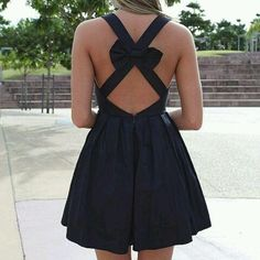 sexy back with a bow pinned on cross straps..