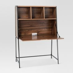 The Threshold™ Darley Drop-Down Desk combines tradition and innovation to form a space-saving solution for a work space or home office. Based on secretary desks, this modern piece makes it easy to spread out during work sessions. When not in use, the wooden desk surface flips back up to conserve space. Three cubbies of wooden shelving remain exposed for easy access to items that must remain within reach—or proudly on display.