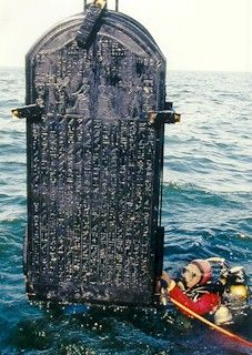 A tablet of Hieroglyphs is raised from water, Alexandria, Egypt