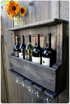 Rustic wine and glass rack with a shelf made from pallets.