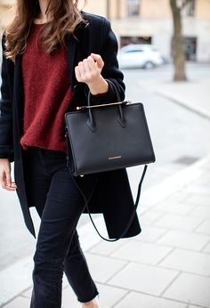 Caroline Blomst carries The Strathberry Midi Tote in Navy
