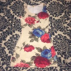Forever 21 Beige Dress with Red and Blue Flowers Forever 21 beige dress with red and blue flowers. Size small, worn once, like new! 94% cotton 6% spandex, this dress definitely has stretch and is fitted. Super cute with or without tights or leggings. Forever 21 Dresses Mini