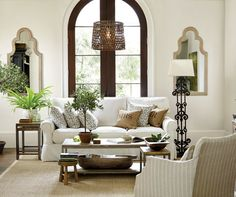 A mix of wood tones and textures keeps this neutral living room from feeling boring.