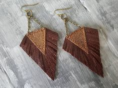 Dark Red Earrings. Leather Earrings. Boho Earrings. Bohemian Earrings. Red Bronze Earrings. Leather Fringe Earrings. Boho Chic Jewelry. Materials: leather,bronze jewelry findings. Color: dark red,bronze. Length with hooks: 9.5 cm( 3.75) If you have any questions, please contact me. You
