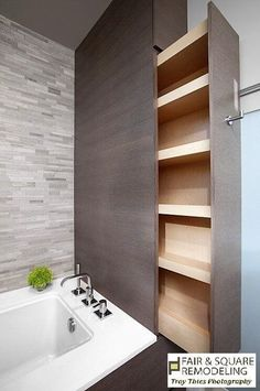 Hidden Sliding Shelf in a Small Bathroom