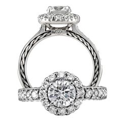 Anadaré diamond engagement ring featuring a prong set round cut center stone that is surrounded by a micropavé round halo and a single row diamond shank with rope detailing on the band profile.