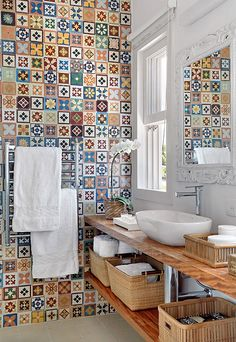 tiles http://www.digsdigs.com/31-multi-color-tiled-bathroom-designs/