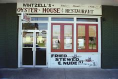 I grew up in Mobile, Alabama eating oysters at Wentzell's, sometimes even cooked.  This is an historic venue with the  wit and wisdome of Oliver Wentzell plastered over every available space.
