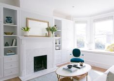 Using a classic Ikea wardrobe and giving it a paint, mirror and brass hardware makeover totally transformed this San Francisco apartment into a gorgeous, bright space with the ultimate in chic storage. Marble Fireplaces, Fireplace Mantels, Fireplace Makeovers, White Fireplace, Fireplace Wall, Fireplace Ideas, Fireplace Design, Small Space Living, Living Area