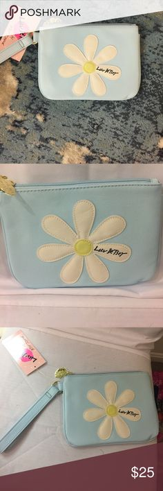 """New Betsey Johnson flower clutch/wristlet blue! Brand new clutch or wristlet made by Betsey Johnson. Color is a baby blue. Big flower on the front. Gold zipper closure shaped like lips. Says """"Luv Betsey"""" on the front. Loop handle to wear on wrist. Interior cloth striped Betsey Print. No trades . Price Firm . Super cute! H6inches L8inches Betsey Johnson Bags Clutches & Wristlets"""