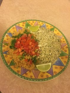 Cauliflower rice with basil & couscous covered in green onions and Roma tomatoes.