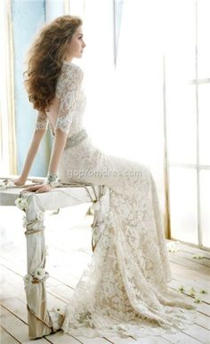 Vintage wedding dress with modern photography by window.