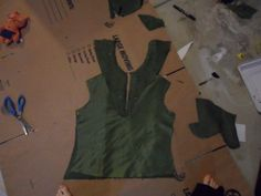 A girl from Ginger Kitty Cosplay is making the same Tauriel costume as I am - lots of helpful stuff on here. Especially this^^ pic, of the dress bodice. How to get the collar and everything. Will have to make another mock-up doing this kind of pattern.