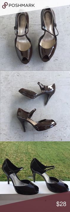 Ann Taylor Heels Darkest chocolate brown patent leather Ann Taylor heels that are a show stopper. In some pics, there are reflections cast off the shoes, that is not damage. They are so beautiful. Please ask if you have questions. Ann Taylor Shoes Heels