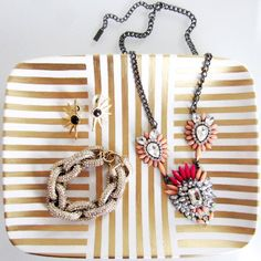 Tape a design on a ceramic plate and apply gold leaf pen to turn it into a chic jewelry tray.