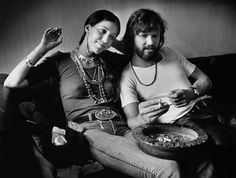 Rita Coolidge and Kris Kristofferson, 1978 rolling a joint! Too bad she hooked up with his woman beating ass.