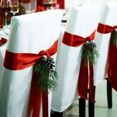 Chair covers with a festive touch adds to the Christmas table decor Find more #christmas ideas at https://www.facebook.com/WestTremontHolidayMarket