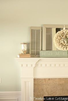 love this paint color (she tells what it is) and this mirror/shutter combo on the mantle.