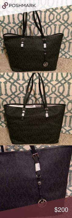 """New Michael Kors Medium Jet Set Monogram Tote Michael Kors Medium Jet Set Travel Tote in Black •New with tags •Dimensions: 15""""W x 11""""H x 5""""D •Handles with strap drop of 9"""" •Zipper Closure •Retails for $248  Check out my other listings- Nike, adidas, Michael Kors, Coach, Wildfox, Victoria's Secret, PINK, Under Armour, True Religion and more! KORS Michael Kors Bags Totes"""