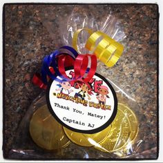 Simple Jake and The Neverland Pirates party favors for 4th Birthday Party. Chocolate coins (gold doubloons), custom labels, ribbon and cellophane bags.