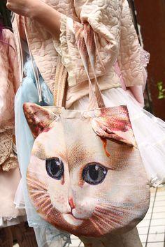 Cat bag. @Kristin Paton I'm buying you this!