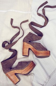 Obsessing over these platform clog sandals by Free People with wraparound straps that can be worn all the way up to the knee or kept around the ankle for versatile styling options.