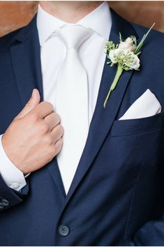 Groom Wedding Inspiration in a Navy Suit, White Tie, Shirt, Handkerchief, and Boutonniere at a. Navy Blue Groomsmen, Navy Blue Tuxedos, Navy Groom, Groom And Groomsmen, Navy Suits, Blue Suit Groom, Tuxedo Suit, White Tuxedo Wedding, Blue Suit Wedding