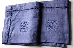 STUNNING pair of french vintage linen cases, pillow cases, dyed in navy blue, hand embroidered monogram MRC. €33,00, via Etsy.