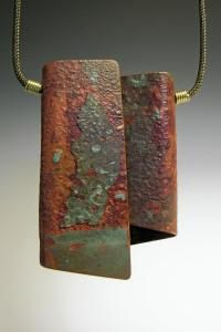 Low Impact Jewelry by McKenna Hallett | McKenna gathers old metal objects such as copper and aluminum from abandoned buildings, old car and appliance parts, radiators and irrigation pipes.  She designs and reshapes these items into a most distinctly beautiful collection of jewelry without using any electricity or fossil fuels.